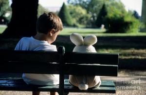 boy-sitting-on-park-bench-with-teddy-bear-sami-sarkis